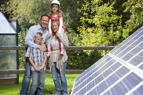 image of family with solar panel